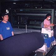Lee Yaw Textile Co Ltd - A staff examining the fabric