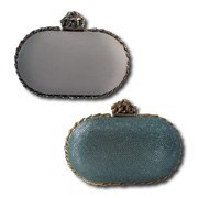 Evening bag with metal-trimmed edge