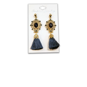 Drop earrings trimmed with cotton tassels