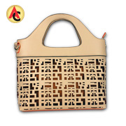 PU leather handbag with laser-cut pattern