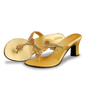 71e504877100 Glitz Marketing s model 01 women s sandals have golden Rexine uppers and  insoles. The former is decorated with faux crystal