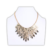 Statement necklace with textured bar fringes