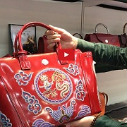 Analyst's Choice: Embroidered leather bags embody China's diverse heritage [VIDEO]
