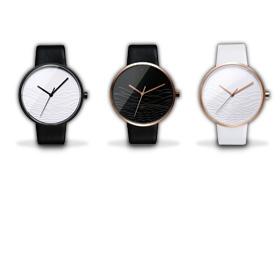 Minimalist fashion watch has debossed face