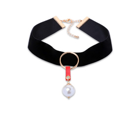 Velvet choker necklace has pearl pendant