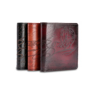 Men's leather wallet has embossed cursive pattern
