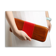 Women's clutch bag made of natural wood