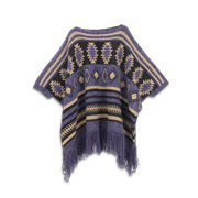 Women's poncho trimmed with thick tassels