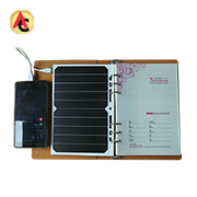 Solar-powered charger attaches to notebook
