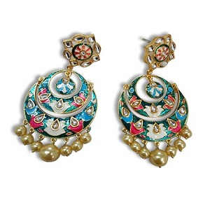 Earrings made of metal, clay and beads
