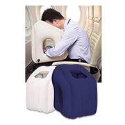 Inflatable travel pillow cradles face, hands