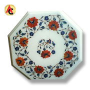 Painted marble tabletop has crystal inlays
