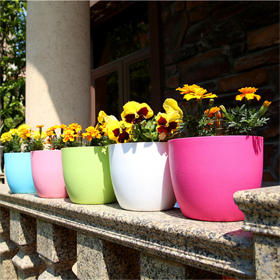 Colorful self-watering flower planter