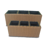 Planter set in handwoven synthetic wicker