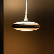 Smart saucer lamp casts light in any direction, angle
