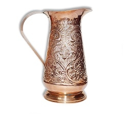 Copper pitcher with embossed floral pattern